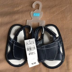 Children place baby shoes